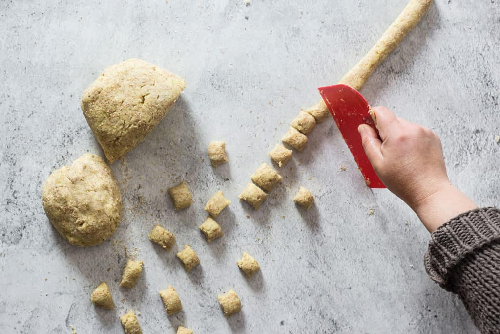 "Cutting the ""ropes"" to make the gnocchi."
