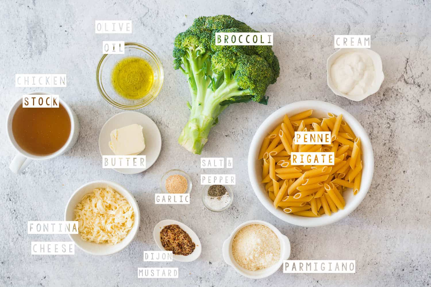 Ingredients for pasta displayed on a concrete surface.