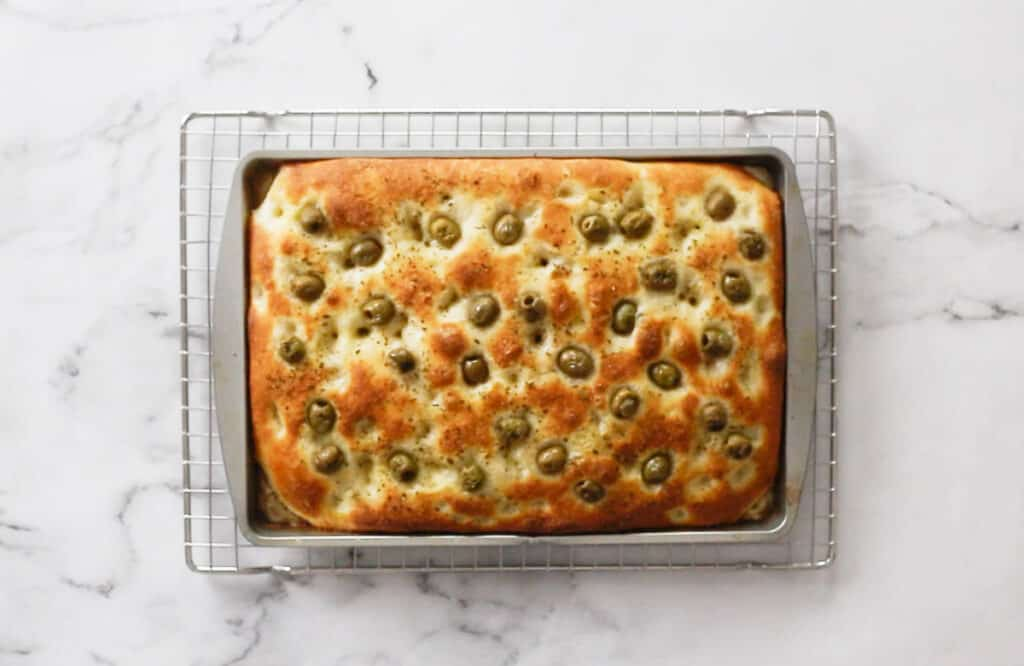 The focaccia with olives just out of the oven after baked.