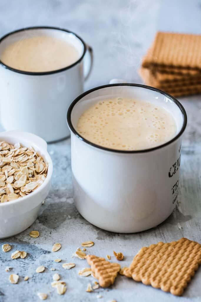 Atole de avena served on white cups.