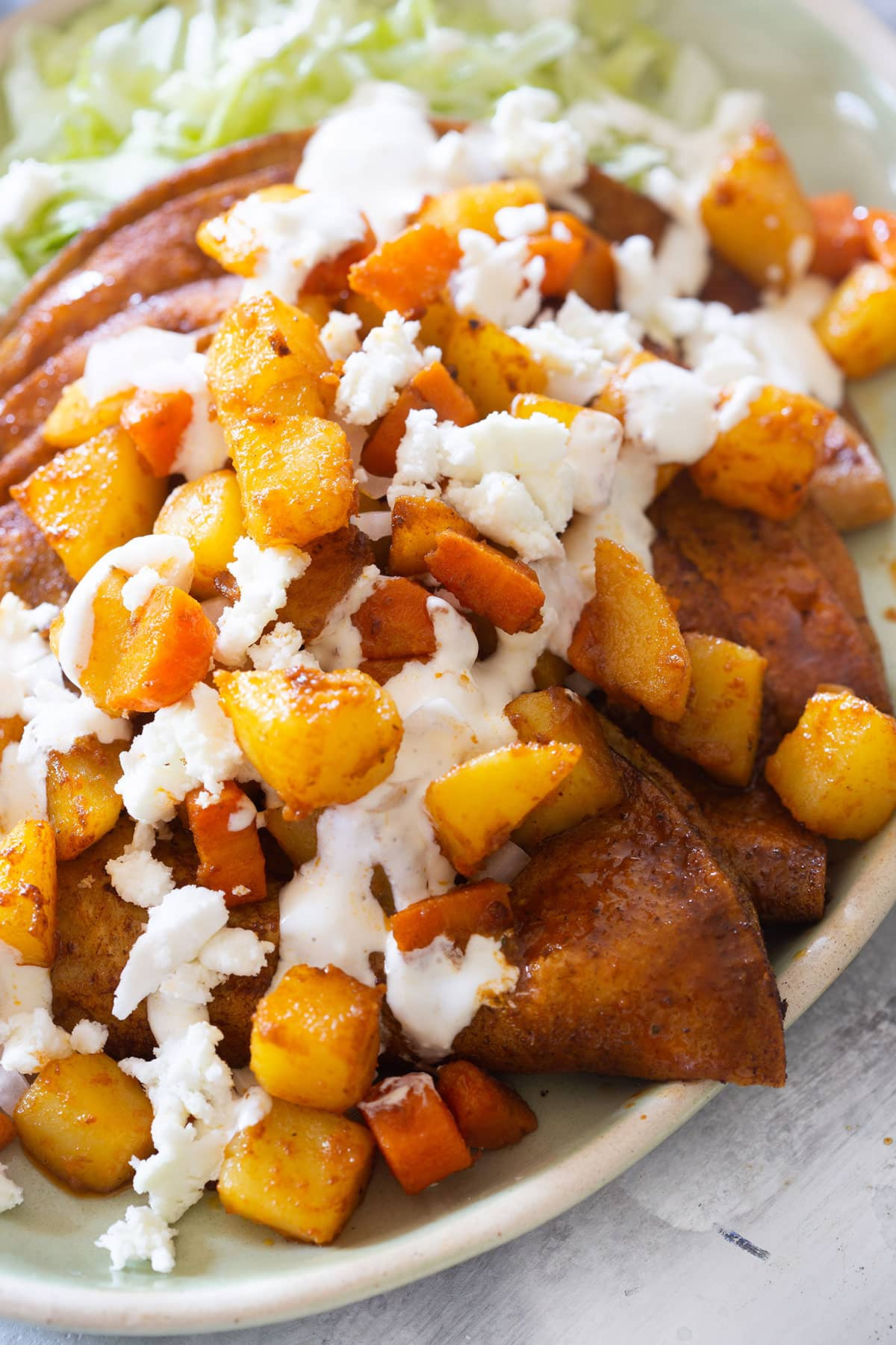 A close up on chicken enchiladas.