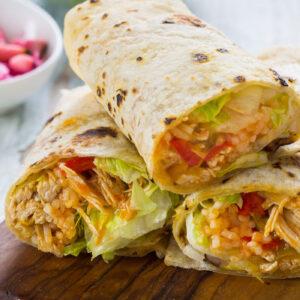 Chicken and rice burrito closeup.