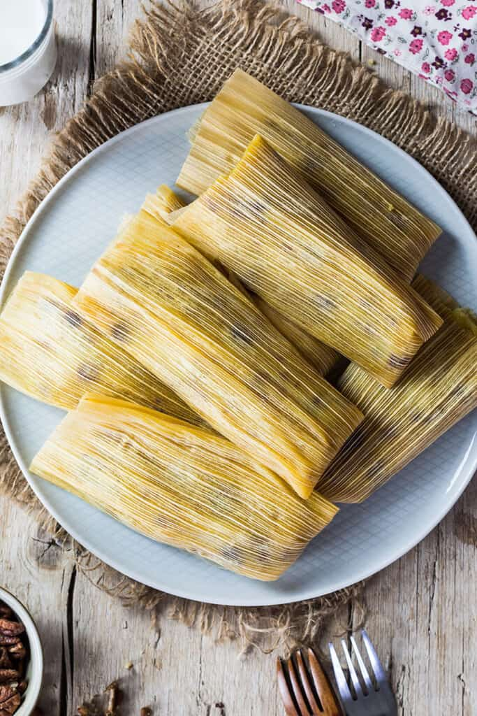 Pineapple sweet tamales piled on a plate, photo from above.