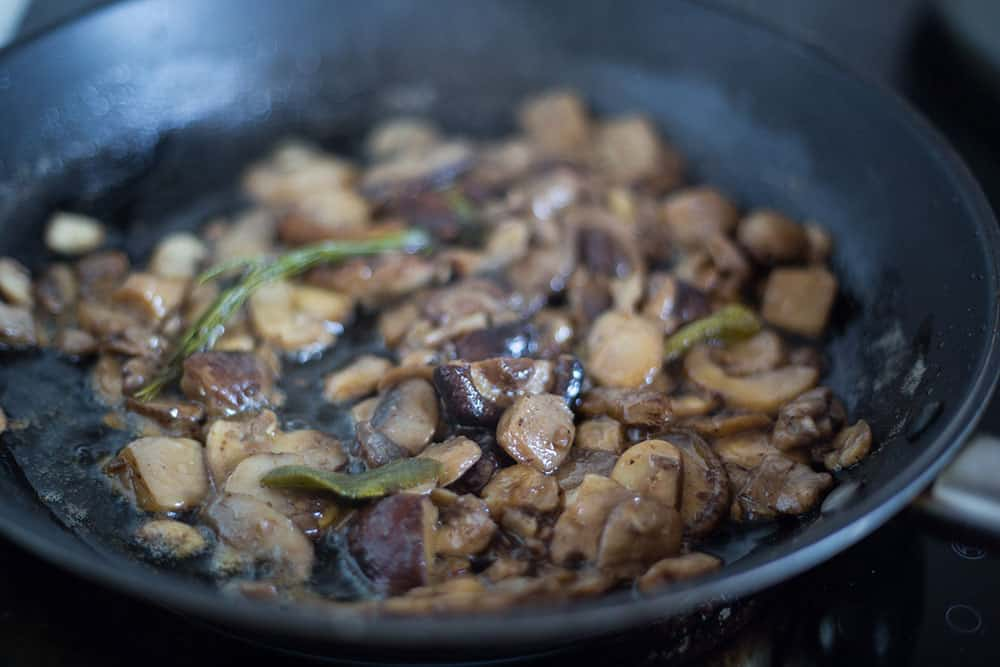 Funghi trifolati on a frying pan.
