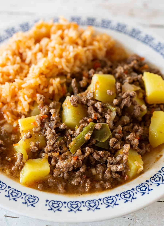 Mexican picadillo recipe served with arroz rojo.