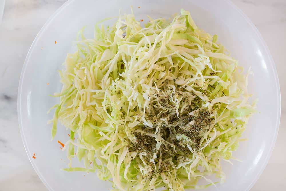 Cabbage added to the bowl.