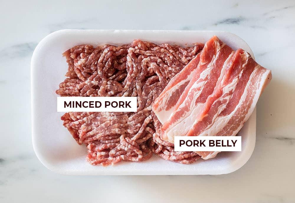 Minced pork and pork belly displayed on a supermarket package.