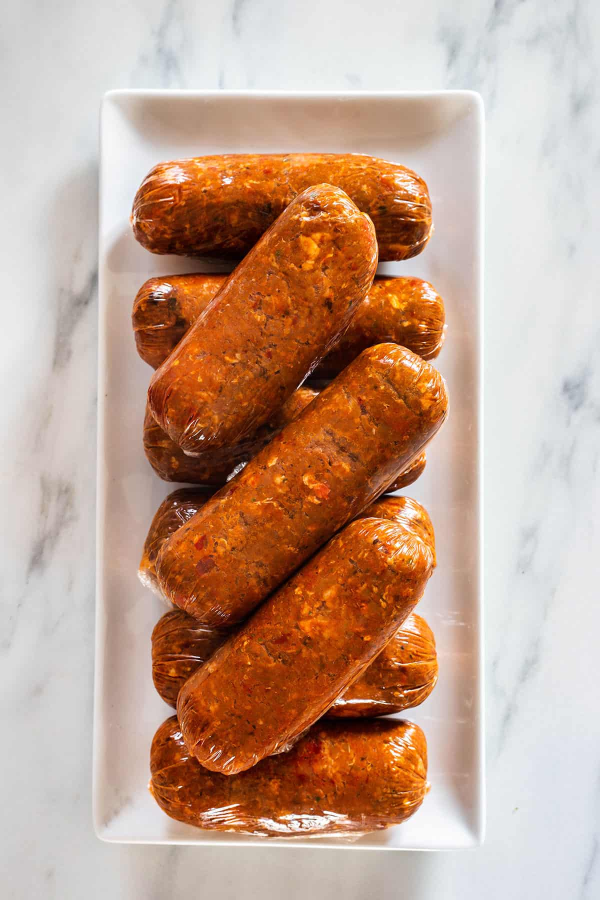 Mexican chorizo on a rectangle white plate seen from above.