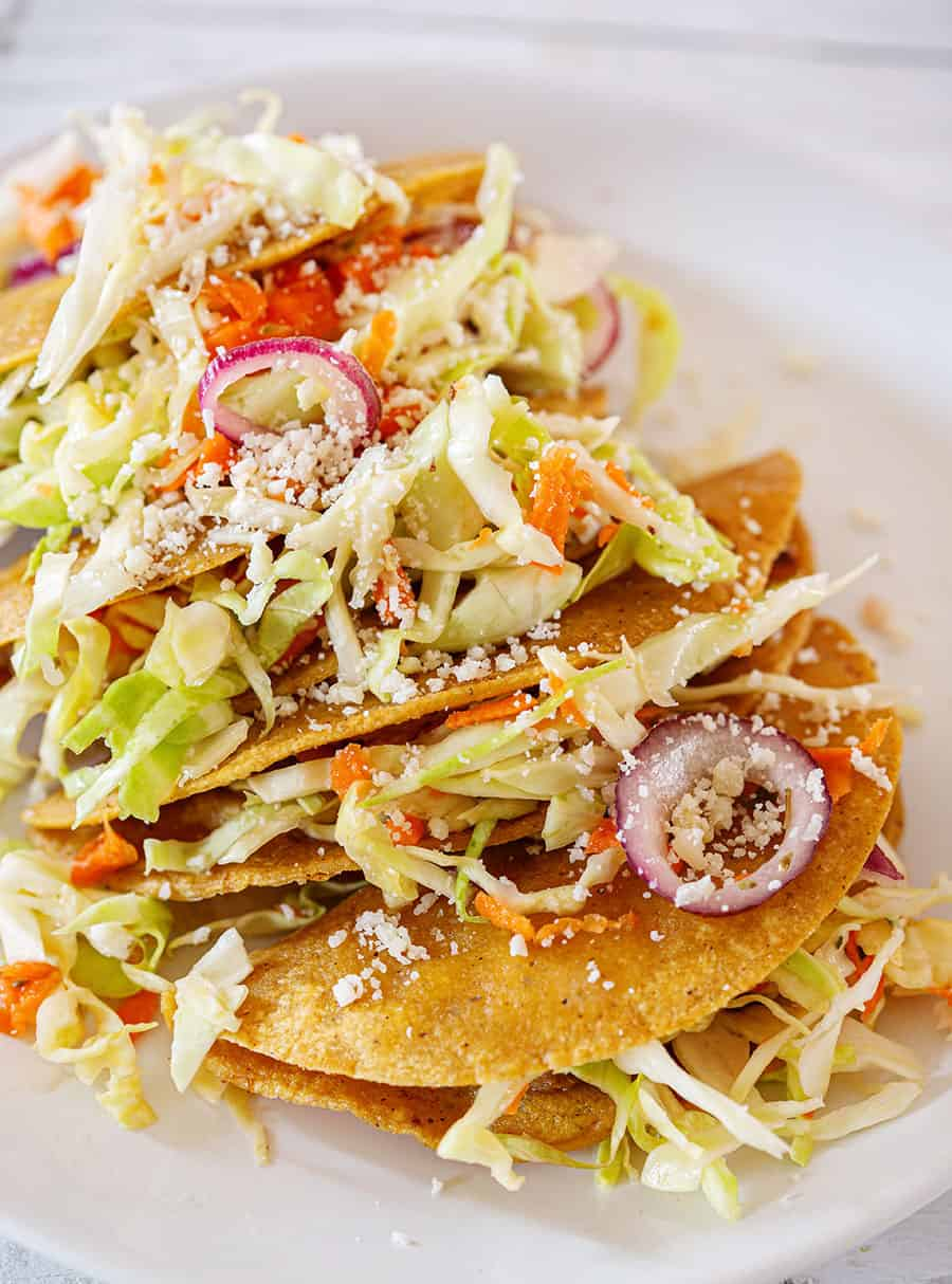 Crispy tacos served with cabbage salad.