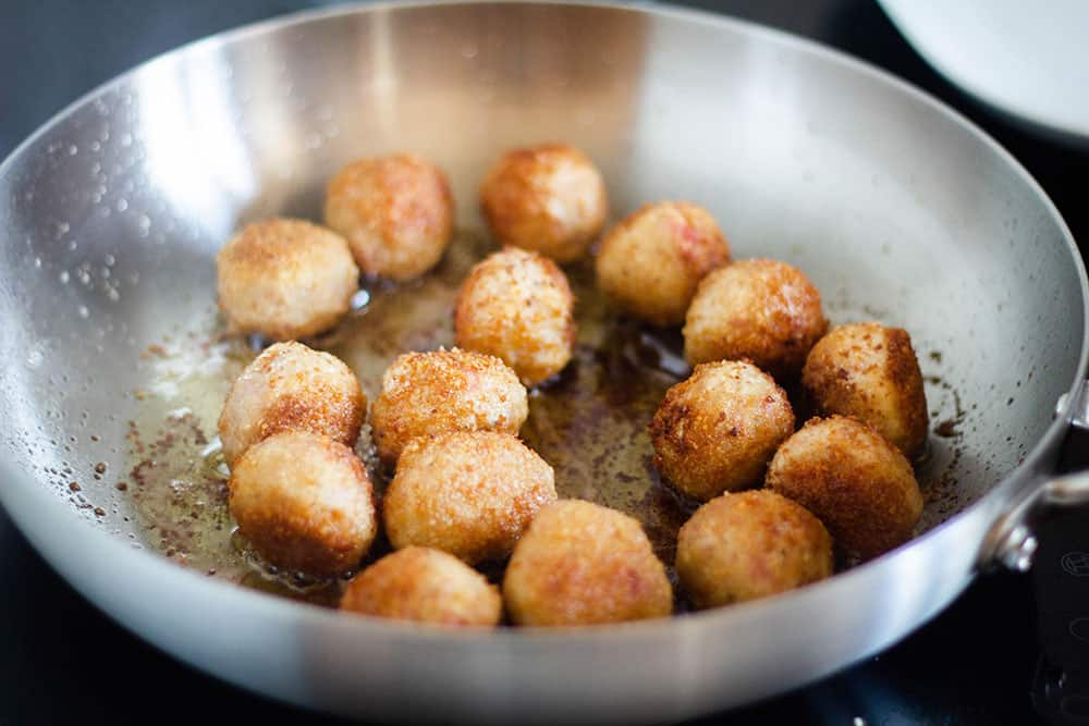 Fried polpette on a pan.