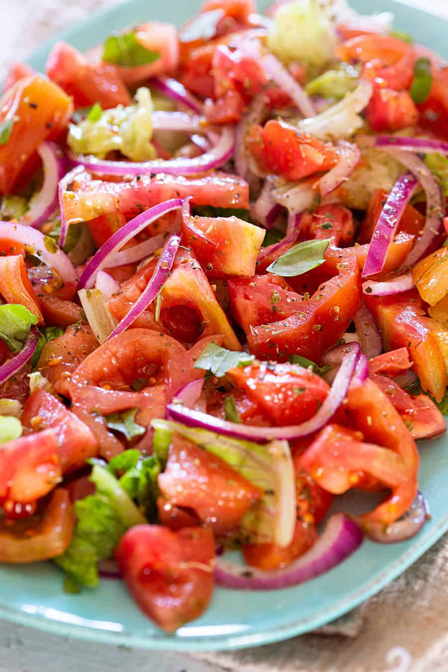 Italian tomato salad on a platter.
