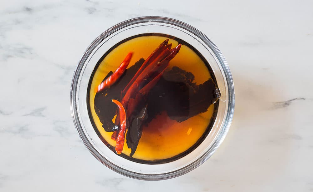 Soaking chiles on a bowl.