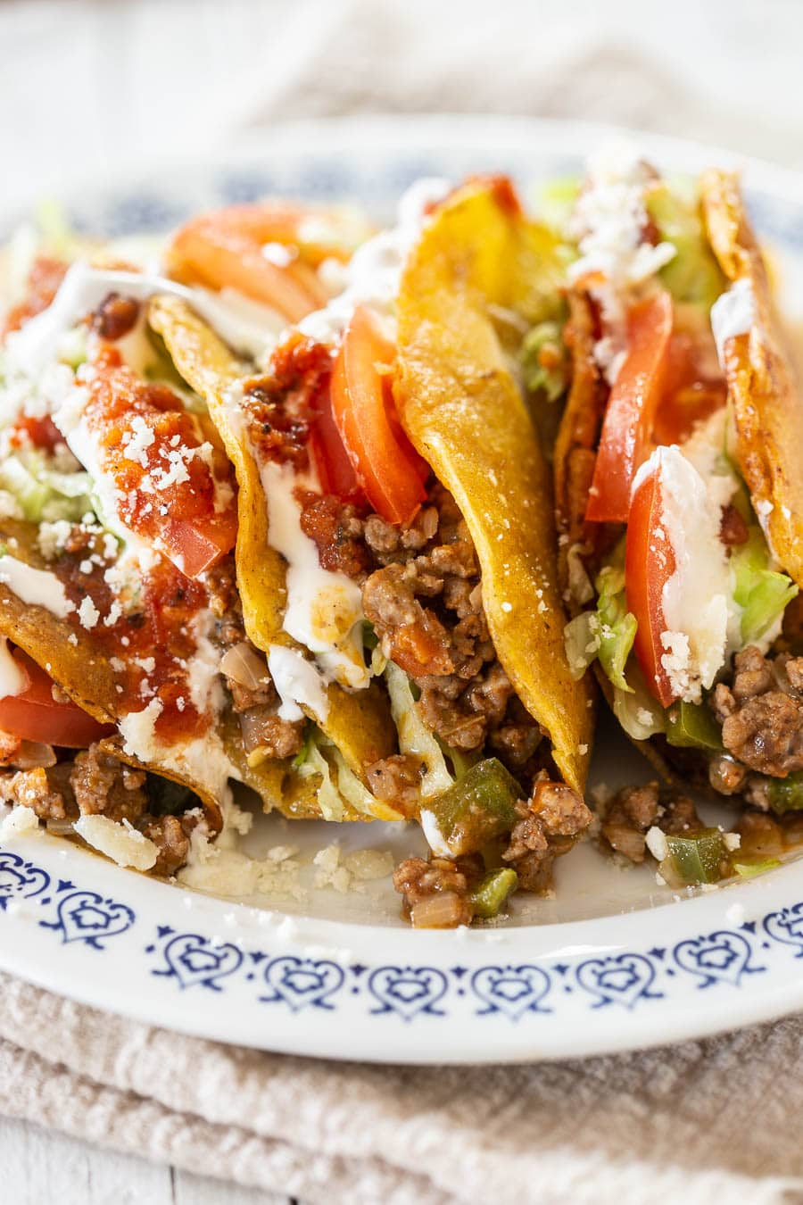 Picadillo tacos on a plate.