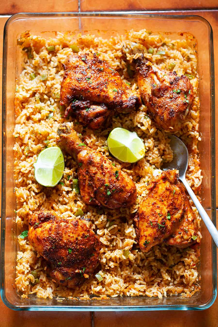 Baked chicken over rice Mexican style on a baking dish.