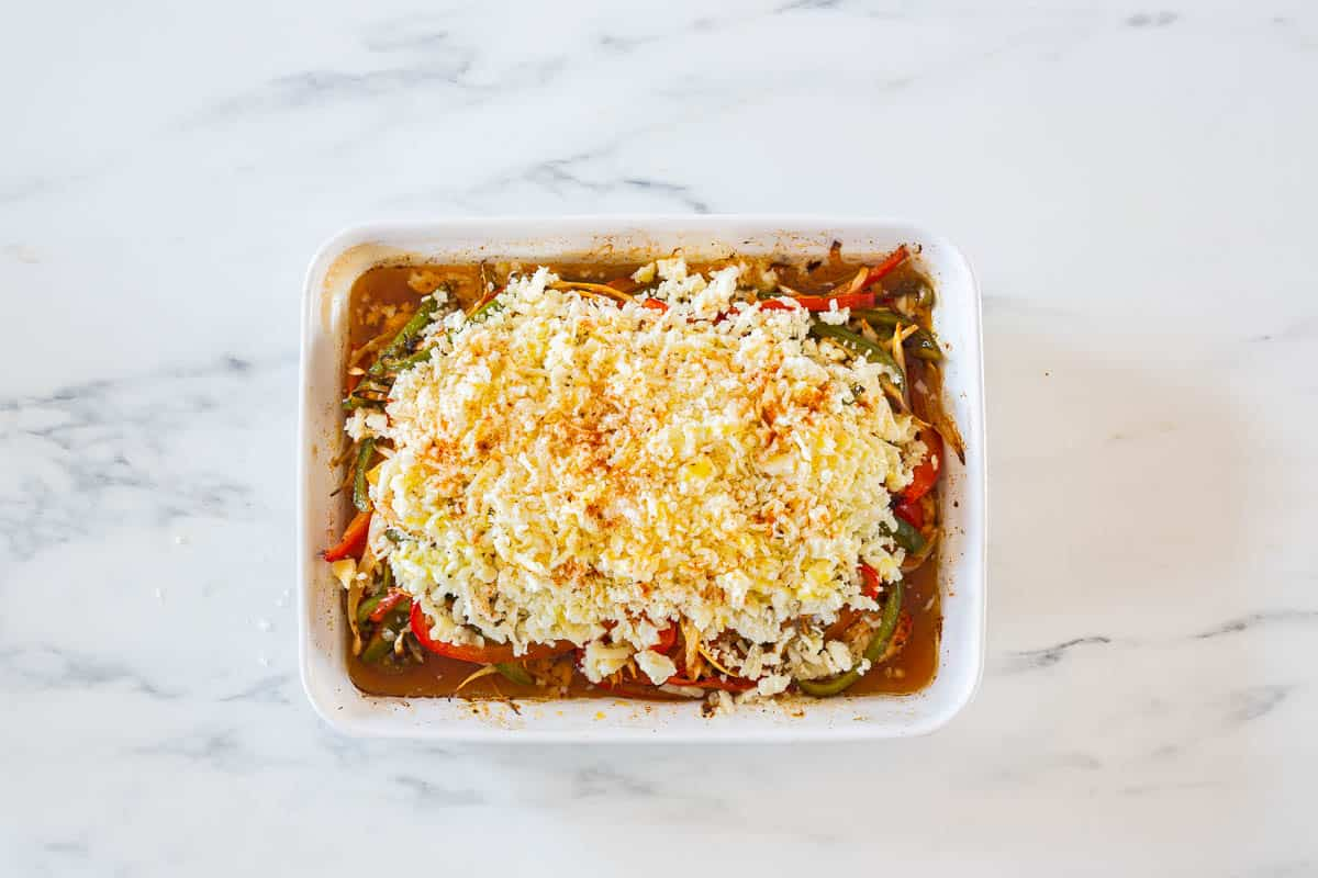 The dish topped with cheese.