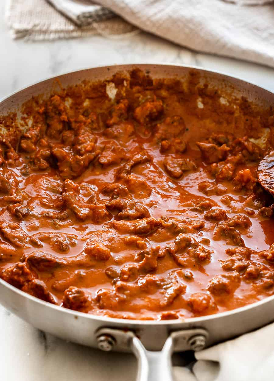 Beef chile rojo on a pan.
