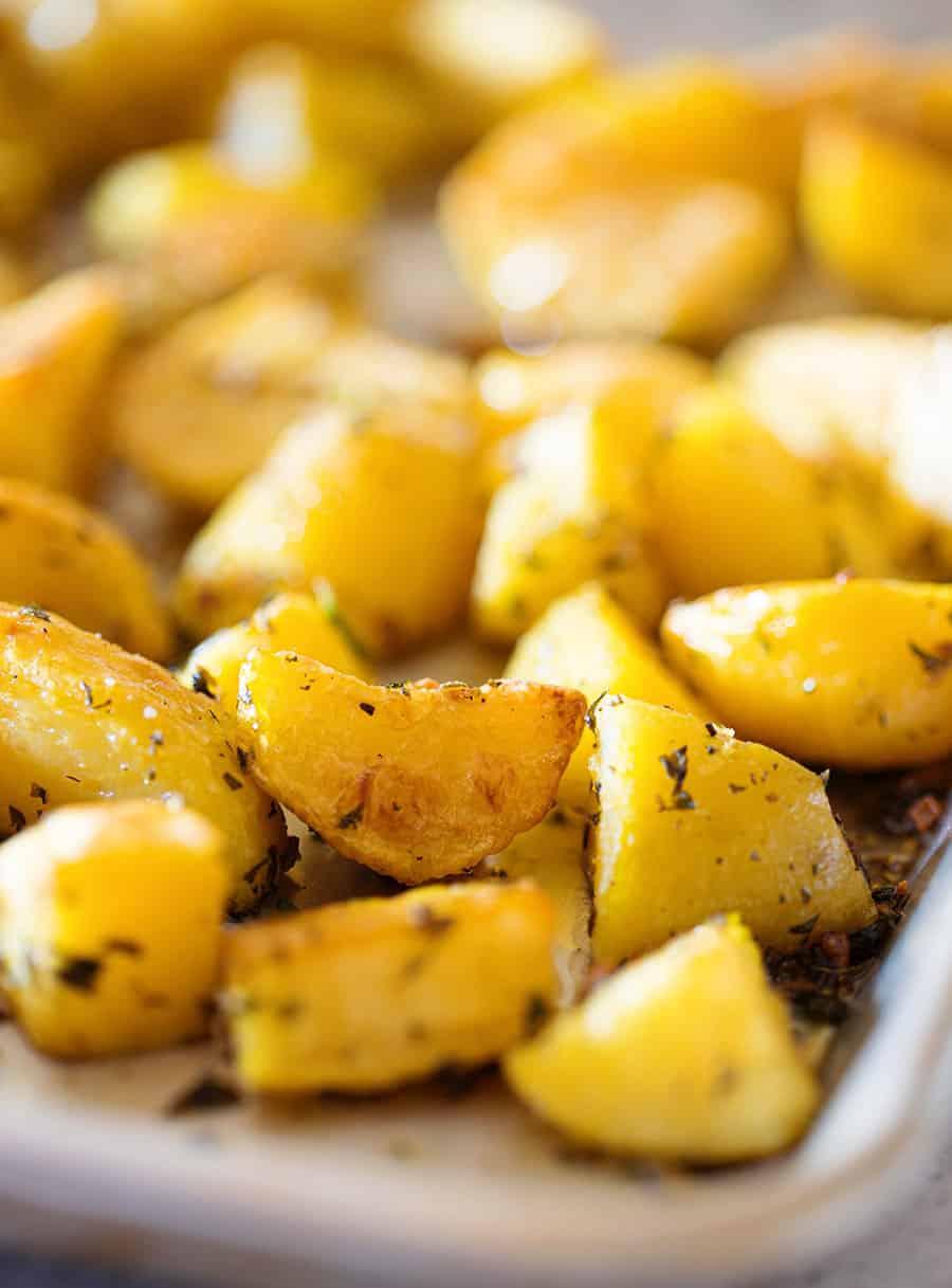 Italian potatoes roasted on a tray.