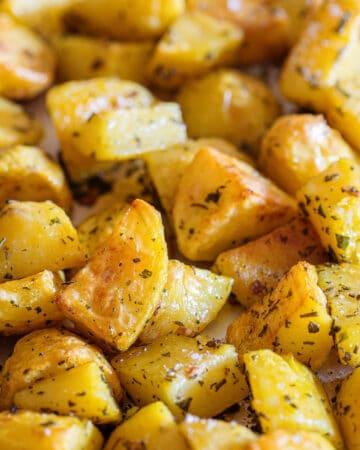 Italian roasted potatoes on a baking tray.