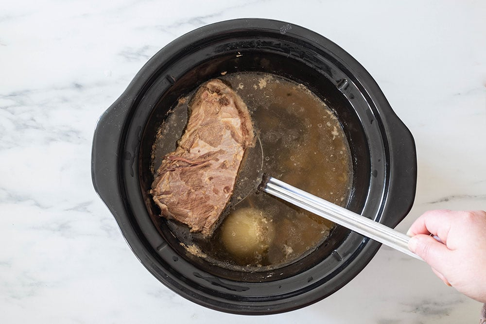 Beef cooked on a crock pot.