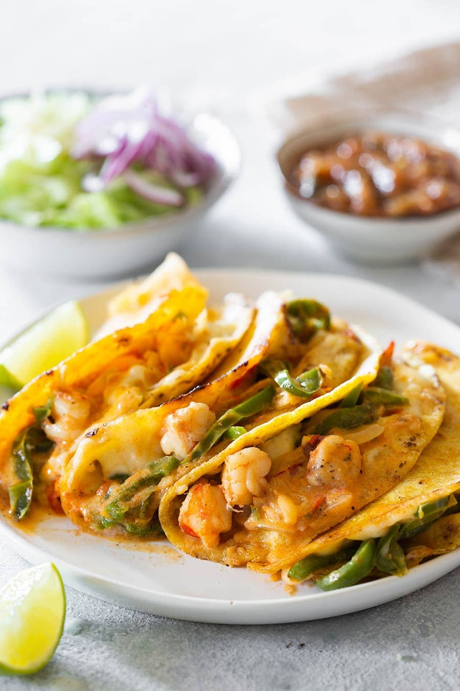 Tacos gobernador with various toppings.