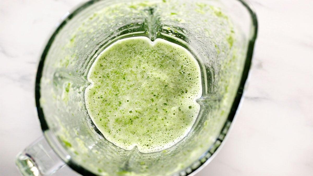 The green salsa inside a blender.