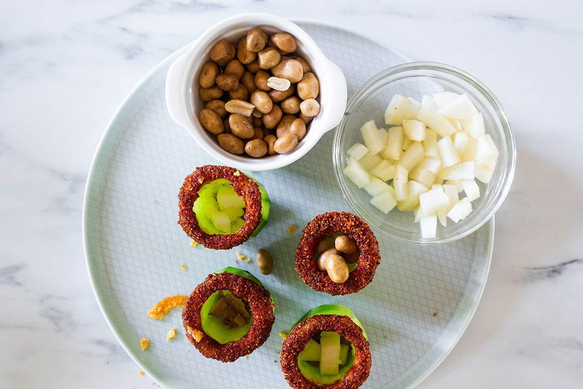 Assembling cucumbers on a platter.