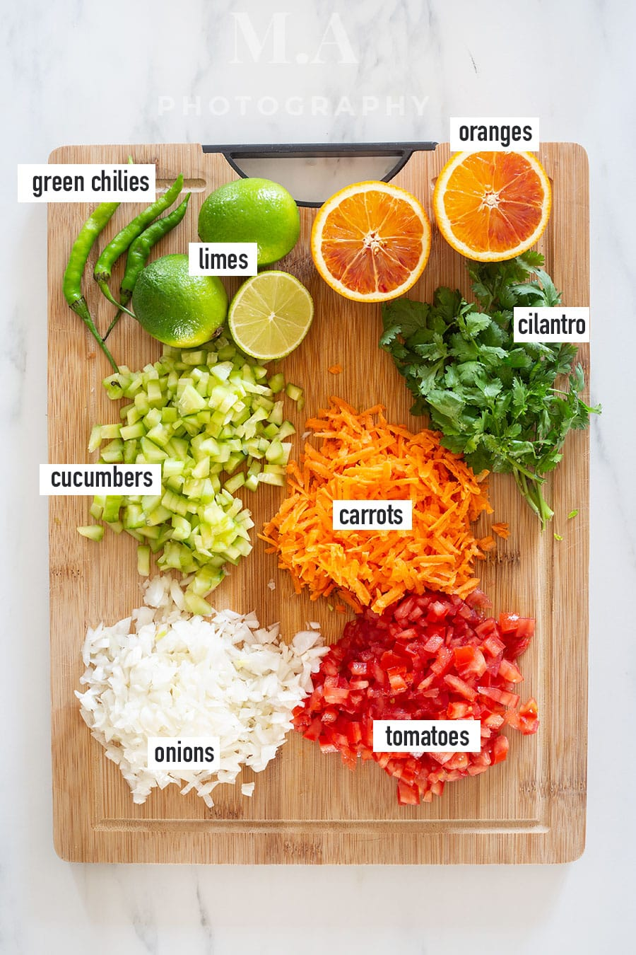 Vegetables diced and chopped on a wooden cutting board.