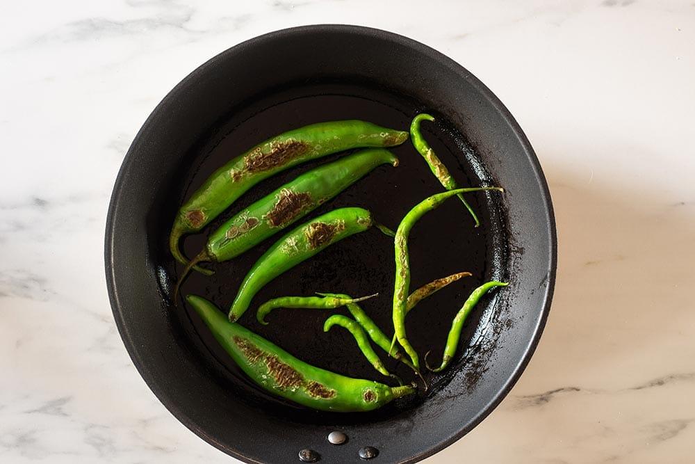 Sauteed chilies on pan.