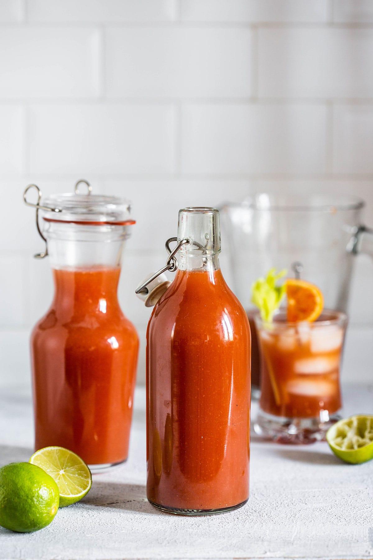 Bottles containing homemade Clamato juice.