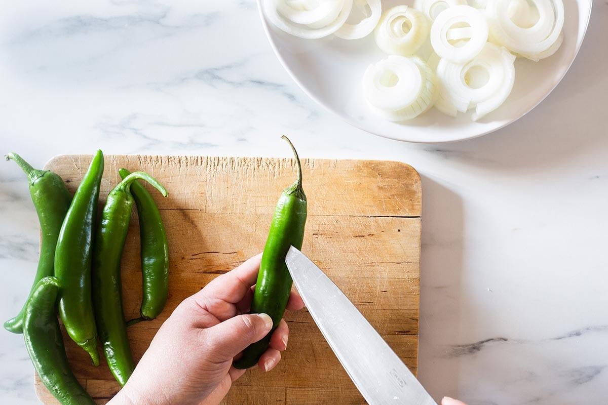 Making a small cut on a chili.