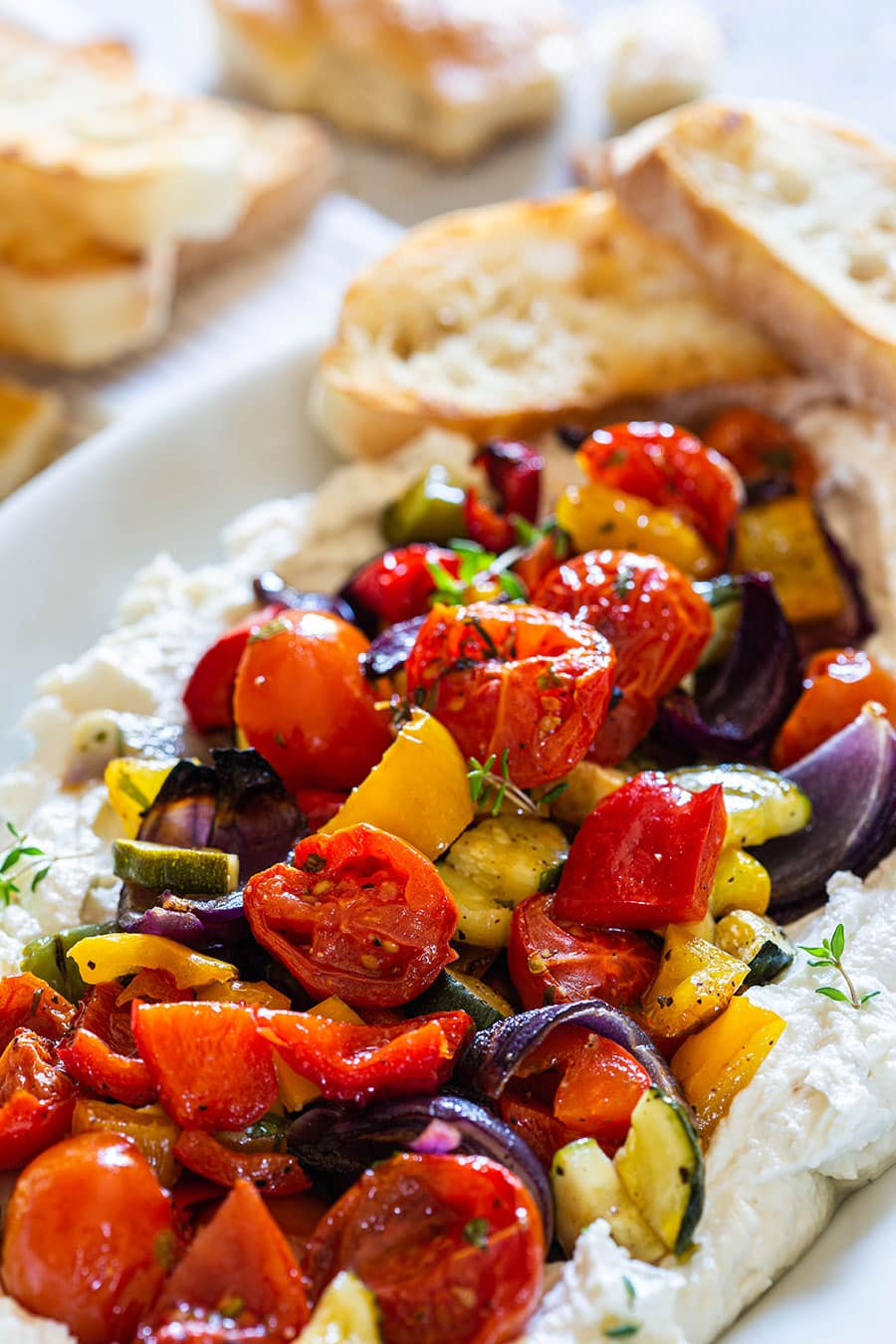 Summer vegetables roasted and served with ricotta cheese.