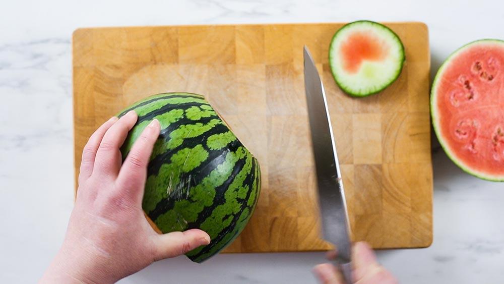 Cutting the watermelon base.