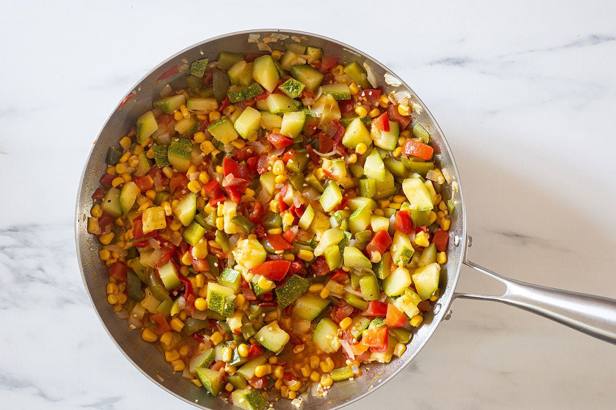 The vegetables already cooked on the pan.