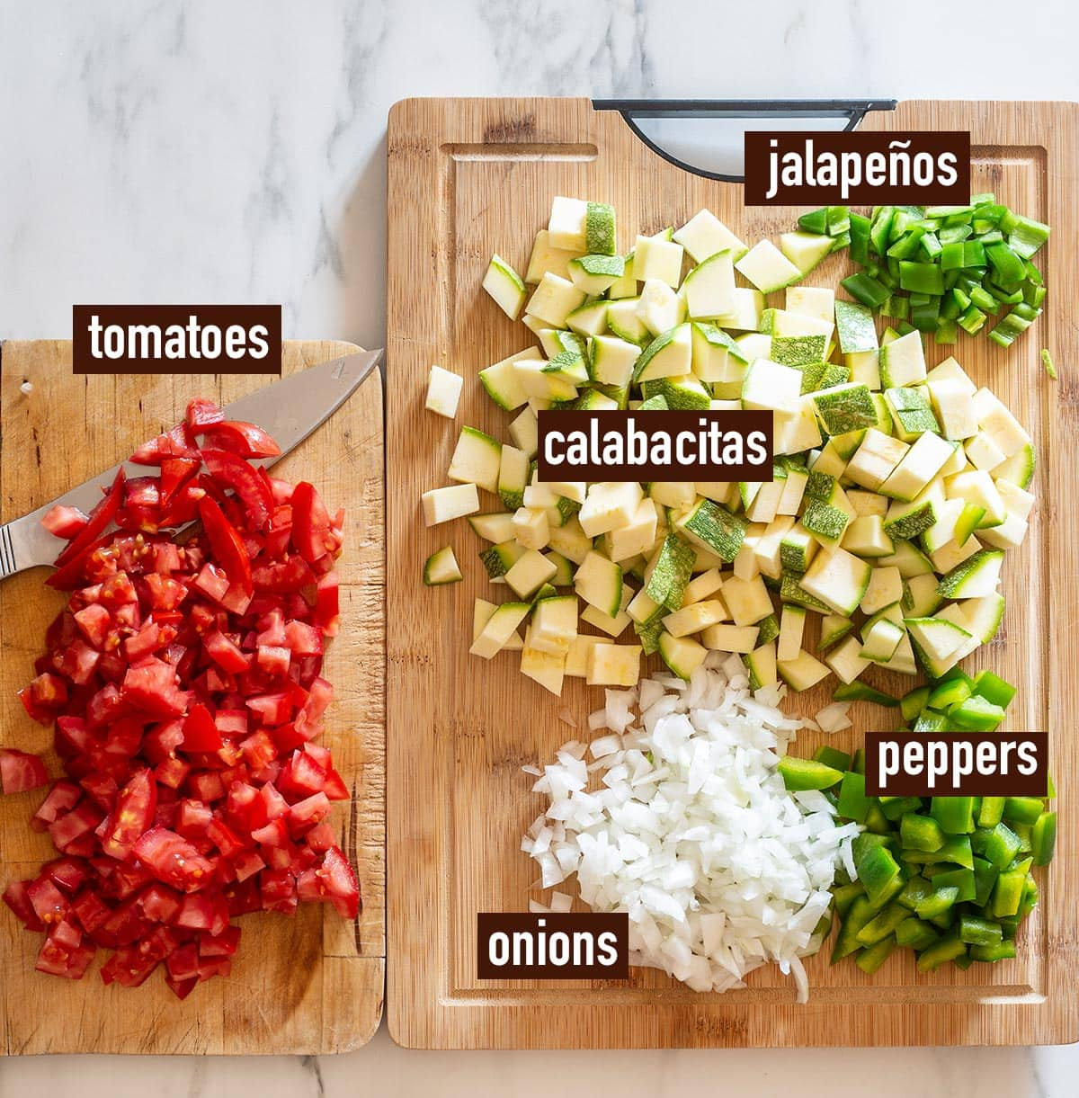 Chopped and diced vegetables on a cutting board.