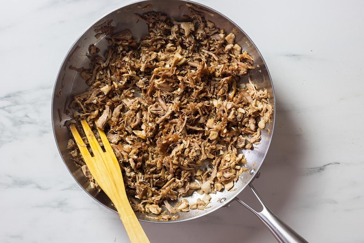 Fried shredded pork meat in a pan.