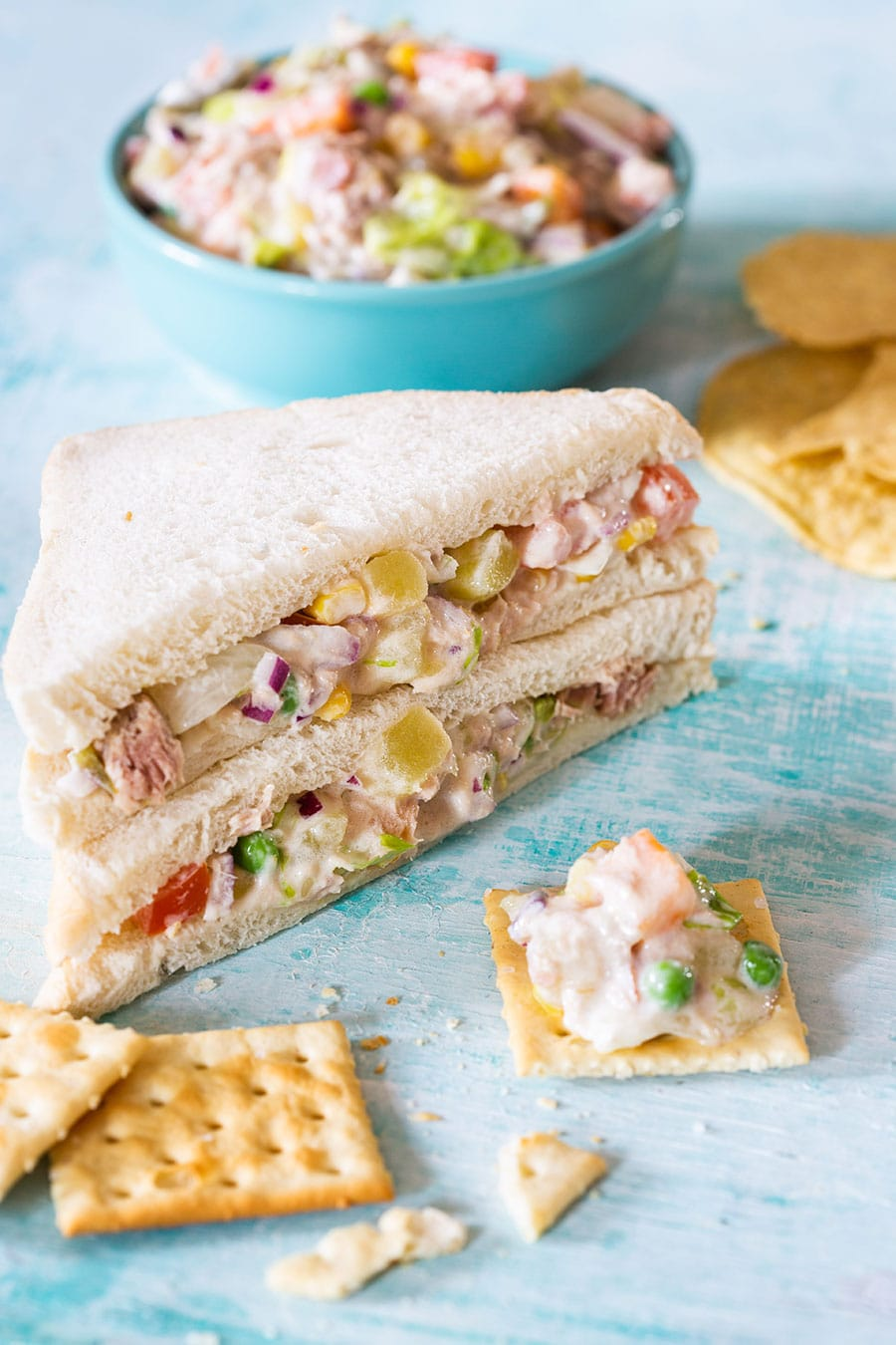 Mexican tuna salad served on a sandwich and saltines.