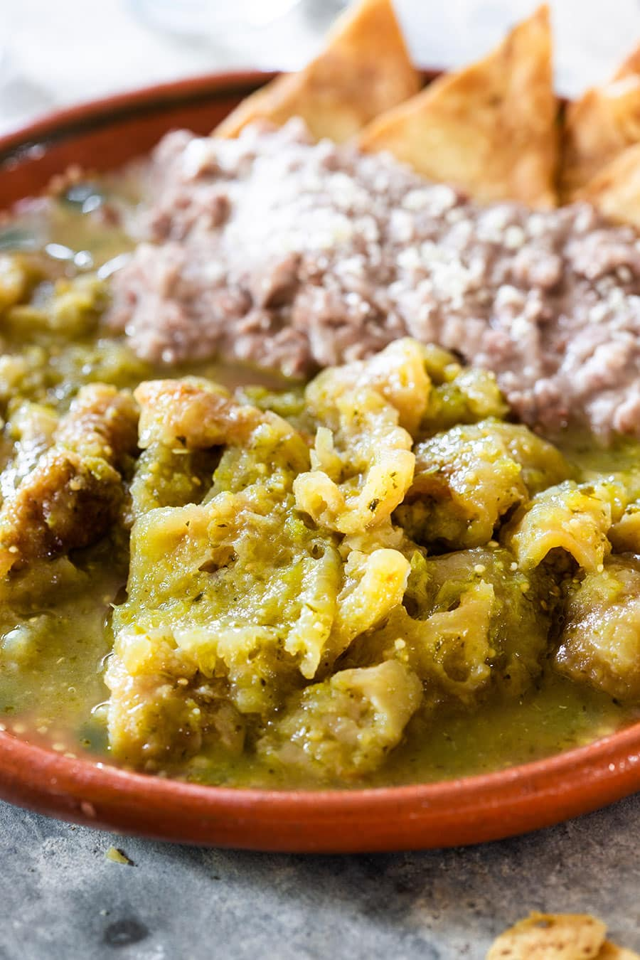 Close up for chicharron en salsa verde (pork cracklings with green sauce).