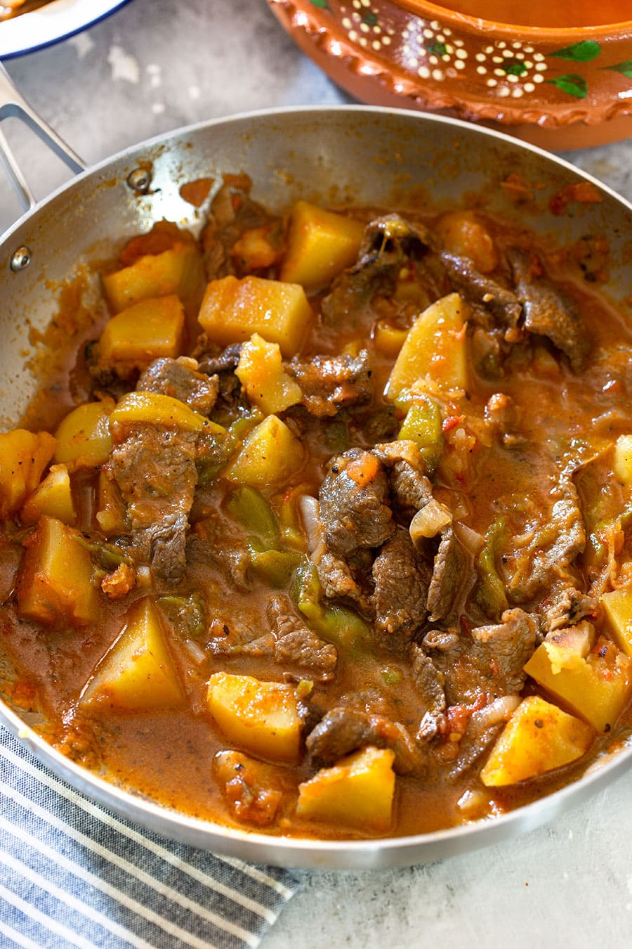 Mexican style beef with tomato sauce, potatoes and chili peppers.