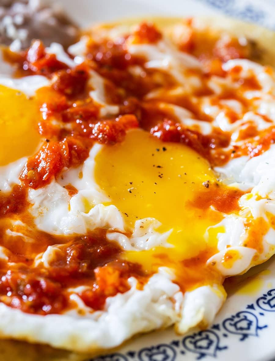 Closeup on runny fried egg's yolk.