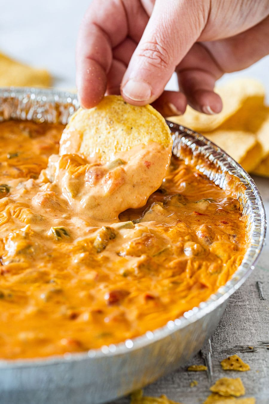 Dipping onto smoked queso.