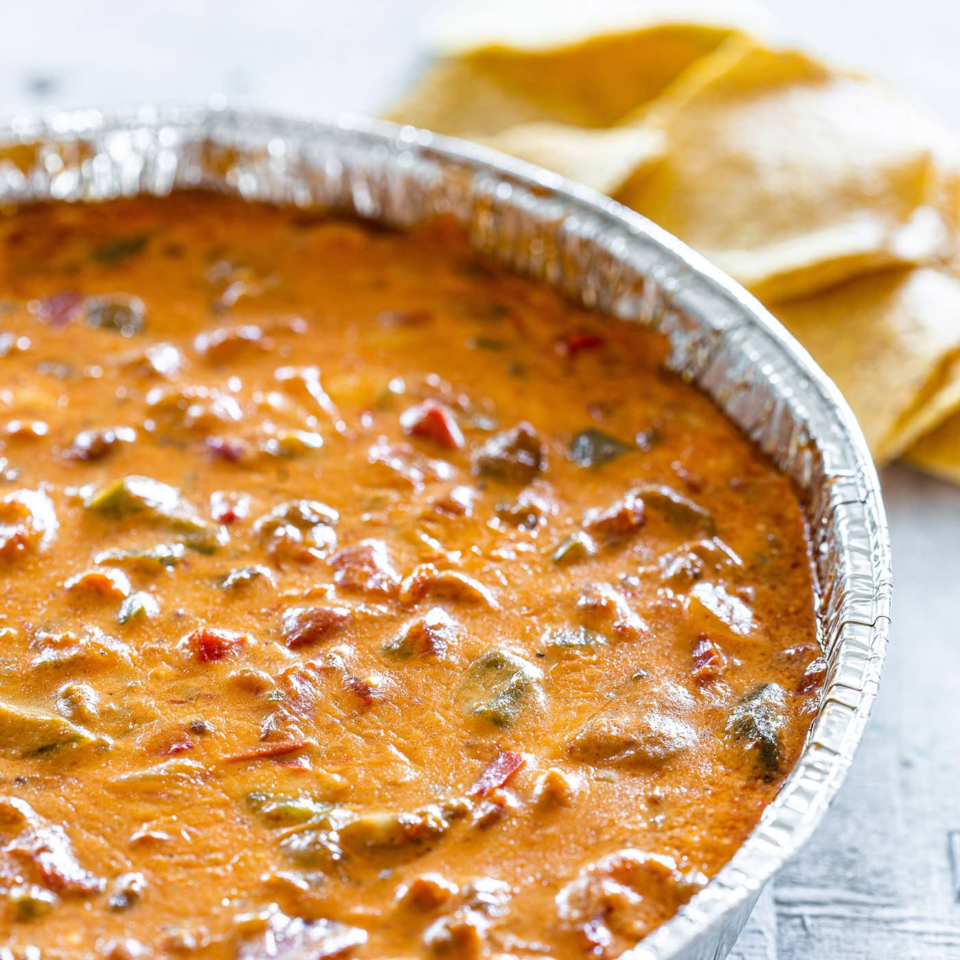 Tex-mex smoked queso recipe on a aluminium foil pan.