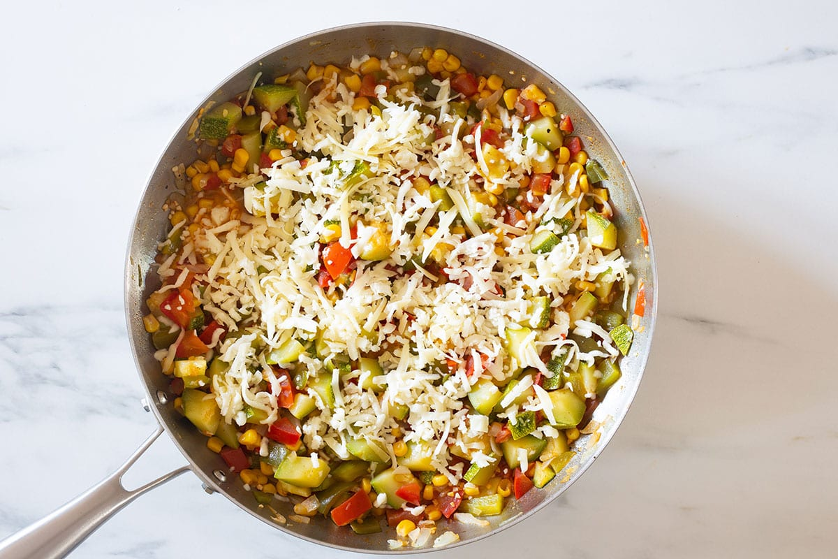 Cheese on top of vegetables.