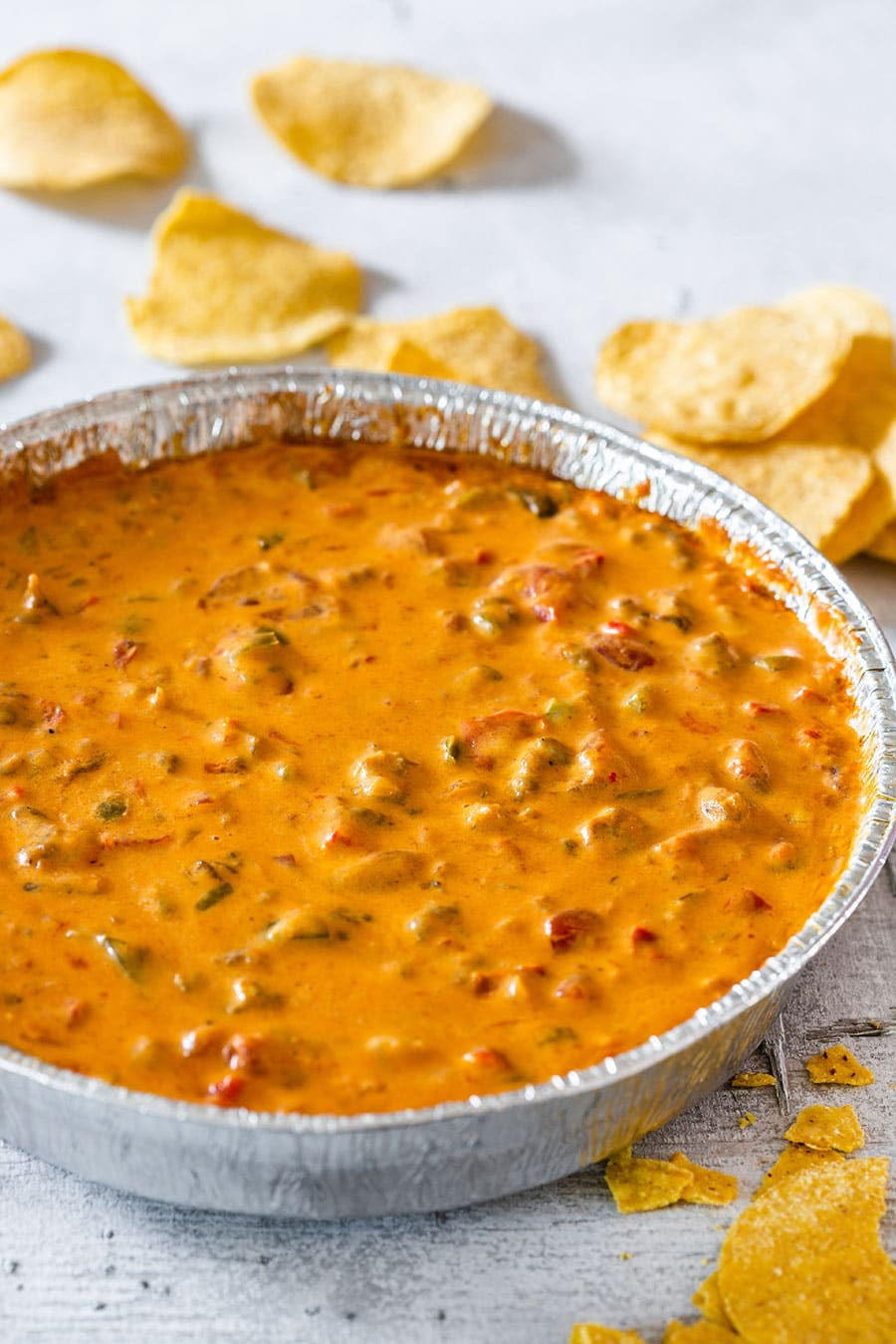 Smoked queso on an aluminium foil pan.