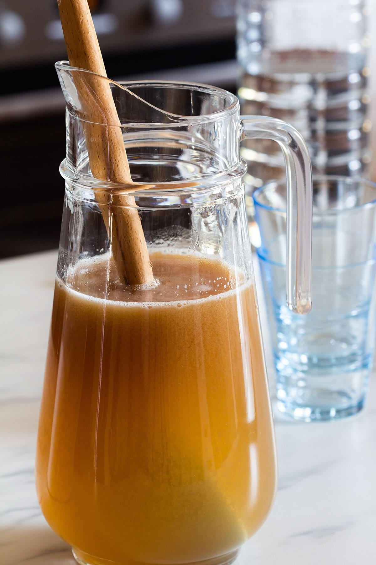Agua de tamarindo (drink) on a pitcher.