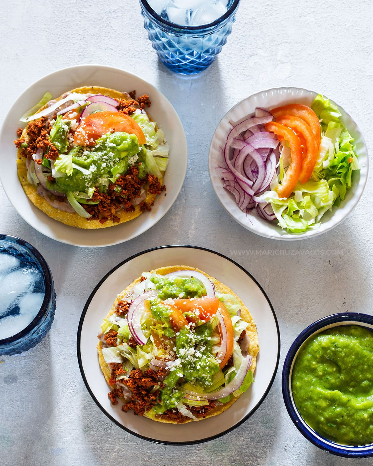 Tostadas de chorizo served on small plates and seen from above.