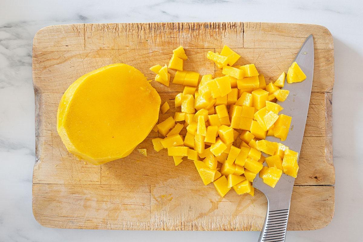 Diced mango on a cutting board.