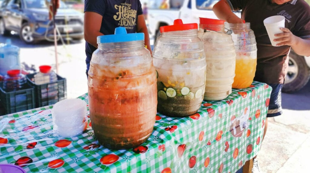 Various glass jugs with Mexican agua fresca in different flavors.