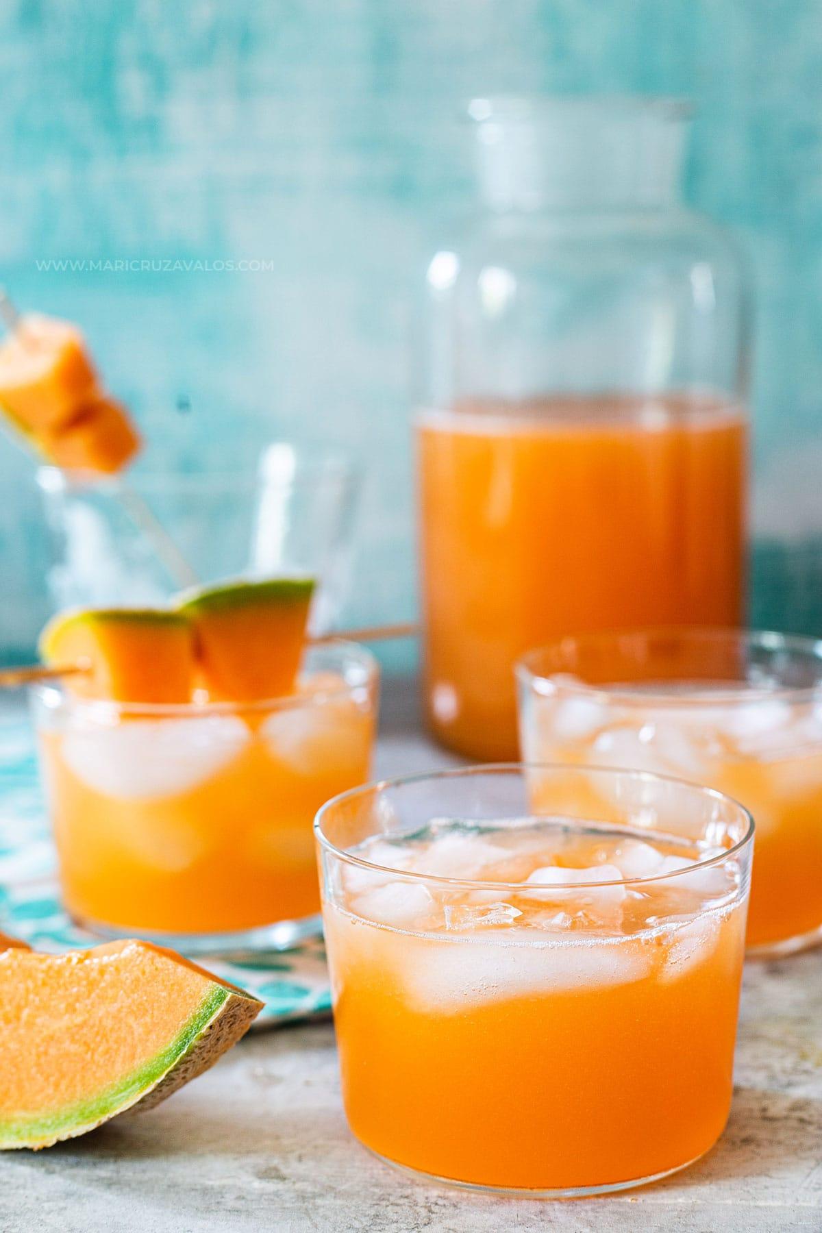 Agua de melon (melon water) served in glasses over ice.