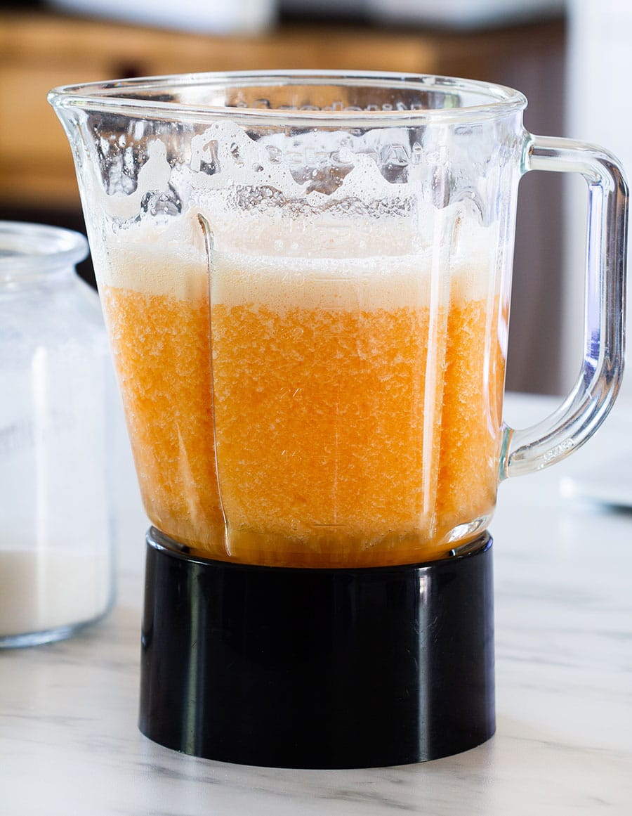Melon blended with water in a blender.