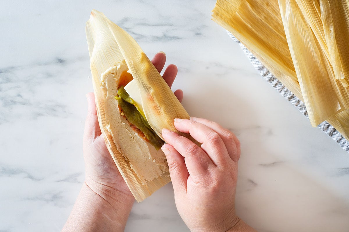 Wrapping a tamal.